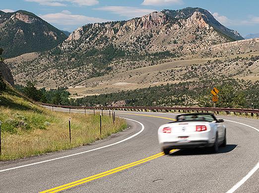 Car driving along mountains