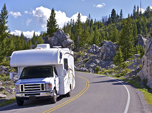 RV driving in a rocky landscape